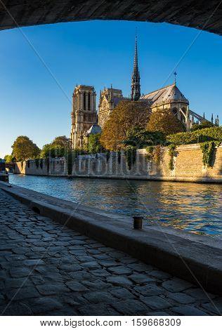 Notre Dame de Paris cathedral at sunset with the Seine River and Ile de La Cite. Paris France