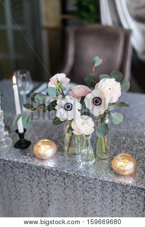 Wedding decor. Wedding interior. Festive decor. Bouquet from spring flowers. Table decor. Table layout. Table of newly married. Restaurant interior.