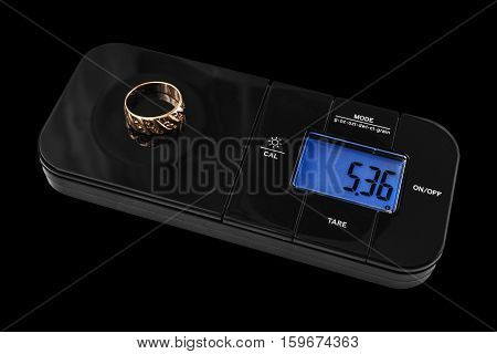 Digital Jewelry scales with golden ring on black background
