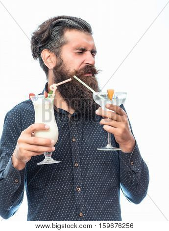 handsome bearded man with stylish hair mustache and long beard on dissatisfied face holding glass of nonalcoholic cocktails isolated on white