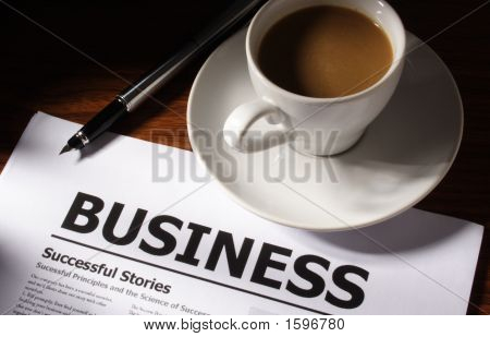 Coffee, Pen And Business File On Table