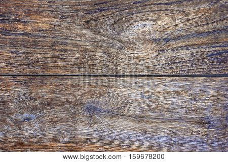 The texture of an old oak planks close-up shot