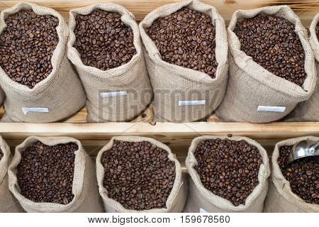 Coffee beans in bags arranged in shop