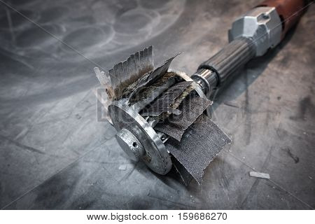 Industrial Sanding Drill With A Sanding Disc And Sandpaper