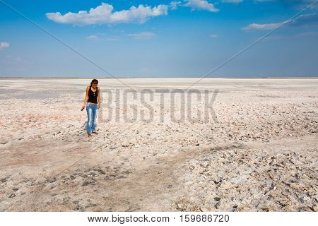 A girl stands on a white bottom of a dried-up salt lake. Siwash. Crimea. 2011-09-04 16:20:29