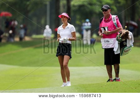 KUALA LUMPUR, MALAYSIA - OCTOBER 29, 2016: Michelle Wie of the USA checks the fairway of the 9th at the TPC Golf Course at the 2016 Sime Darby LPGA Malaysia golf tournament.
