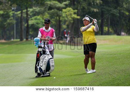 KUALA LUMPUR, MALAYSIA - OCTOBER 29, 2016: Amy Yang of South Korea checks the checks the fairway of the TPC Golf Course at the 2016 Sime Darby LPGA Malaysia golf tournament.