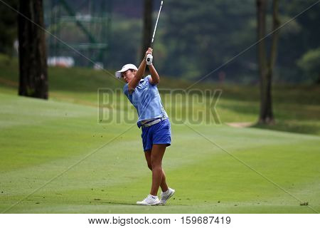 KUALA LUMPUR, MALAYSIA - OCTOBER 29, 2016: Candie Kung of Taiwan plays from the fairway of the TPC Golf Course at the 2016 Sime Darby LPGA Malaysia golf tournament.