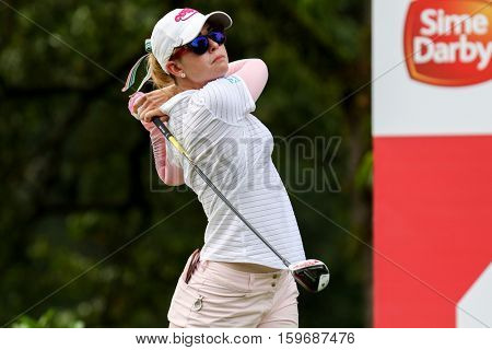 KUALA LUMPUR, MALAYSIA - OCTOBER 29, 2016: Paula Creamer of the USA tees off from the T-box of the 4th hole at the TPC Golf Course at the 2016 Sime Darby LPGA Malaysia golf tournament.