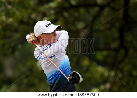 KUALA LUMPUR, MALAYSIA - OCTOBER 29, 2016: Stacy Lewis of the USA tees off from the T-box of the 4th hole at the TPC Golf Course at the 2016 Sime Darby LPGA Malaysia golf tournament.