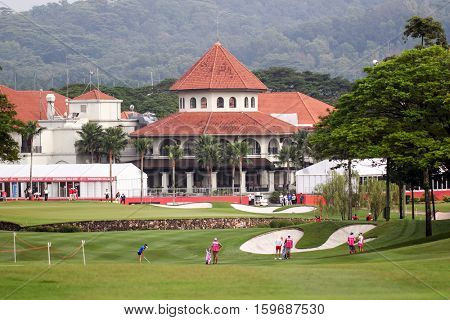 KUALA LUMPUR, MALAYSIA - OCTOBER 29, 2016: LPGA golfers play on the green opposite the clubhouse of the TPC Golf Course at the 2016 Sime Darby LPGA Malaysia golf tournament.