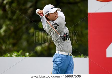 KUALA LUMPUR, MALAYSIA - OCTOBER 29, 2016: Haru Nomura of Japan tees off from the T-box of the 4th hole at the TPC Golf Course at the 2016 Sime Darby LPGA Malaysia golf tournament.