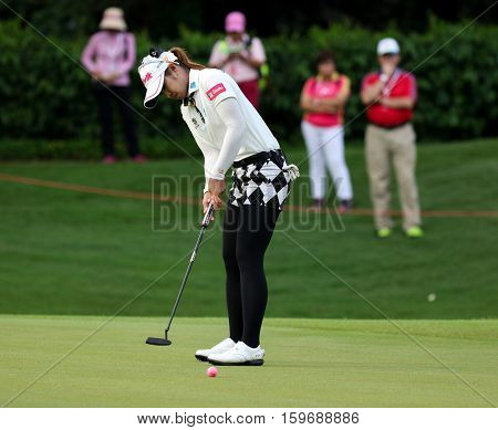KUALA LUMPUR, MALAYSIA - OCTOBER 29, 2016: Pornanong Phatlum of Thailand putts on the green of the TPC Golf Course on Round 3 of the 2016 Sime Darby LPGA Malaysia golf tournament.