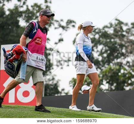 KUALA LUMPUR, MALAYSIA - OCTOBER 29, 2016: Stacy Lewis of the USA walks away from the T-box after tee off at the TPC Golf Course at the 2016 Sime Darby LPGA Malaysia golf tournament.