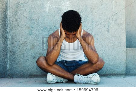 Poor homeless latin young adult thinking about his problems