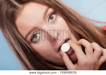Woman Taking Painkiller Pill Tablet. Health Care.