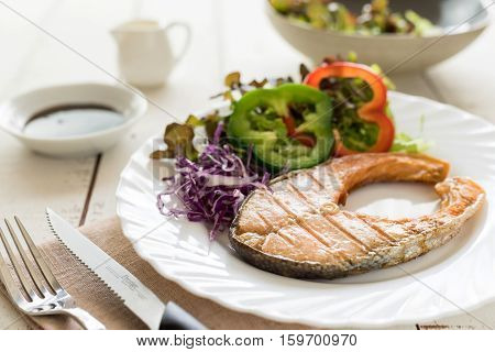 Grilled Teriyaki salmon steak with vegetables healthy style dinner