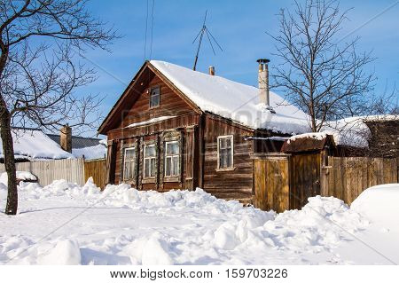 Small wooden house with stove heating in the provincial Russian city