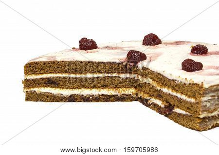 On a white background sliced chocolate cake of sponge cakes with strawberries