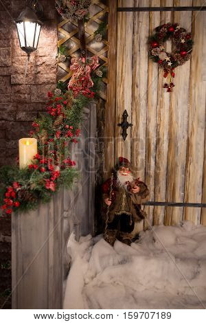 New Year's porch decorated Christmas wreath snow and toy gnome