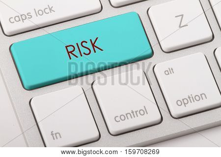 Risk word written on computer keyboard .