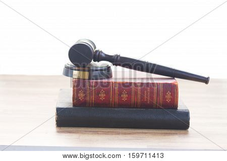 Wooden Law Gavel on books over whte background