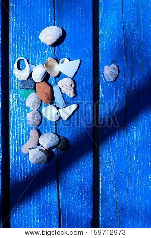 Shells on blue bench by the sea vertical orientation. Flat layout