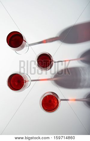 red wine tall glasses with stems isolated on white background view from top