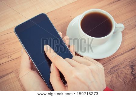 Vintage Photo, Hand Of Woman Touching Blank Screen Of Mobile Phone, Cup Of Coffee
