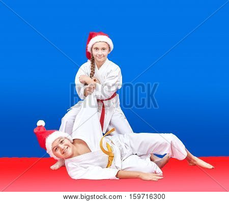 Children with red and yellow belt are training throws