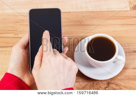 Hand Of Woman Touching Blank Screen Of Mobile Phone, Cup Of Coffee