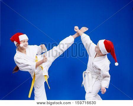 Kick leg and block are training kids in karategi