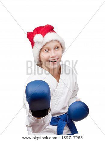 Girl in the cap of Santa Claus is in the rack karate
