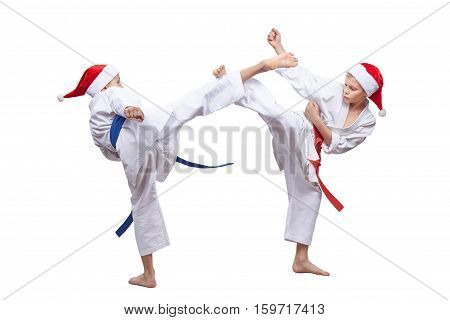 Two karateka are beating kick leg to meet each other