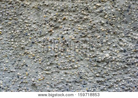 small coloreful stones in cement background texture