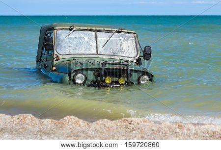 car is sinking in the sea tide
