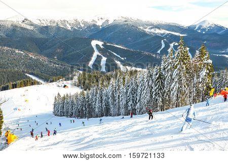 people on the ski run in the resort