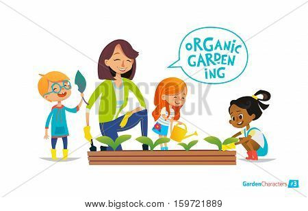 Cute girls and boys help their teacher to care for plants. Teacher and kids engaged in gardening in the backyard. Girl watering flowers in the garden. Eco concept. Montessori education concept. Organic gardening.