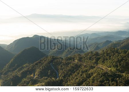View of morning mist and hills at Doi Ang Khang mountain one of the famous mountains in Chiangmai Thailand
