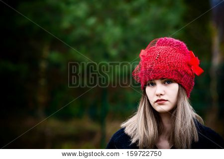 Thoughtful Young Woman In Woolen Red Cap