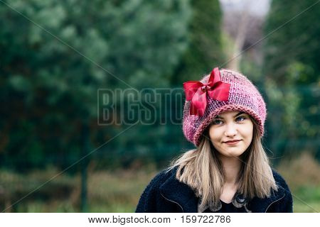 Thoughtful Young Woman In Woolen Cap