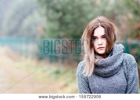 Pensive Beautiful Young Woman In Woolen Sweater
