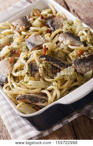 Sicilian Pasta Bucatini With Sardines, Fennel, Raisins And Pine Nuts Closeup. Vertical