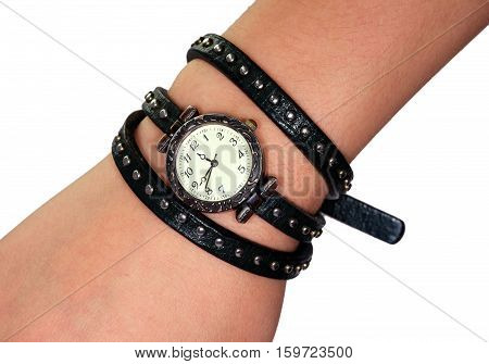 Watch with a strap on a female hand