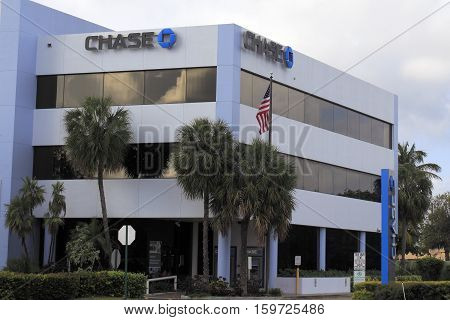 Fort Lauderdale FL USA - April 24 2016: Three large Chase bank signs with logo outside an office building. Chase signs located on the building of the public bank