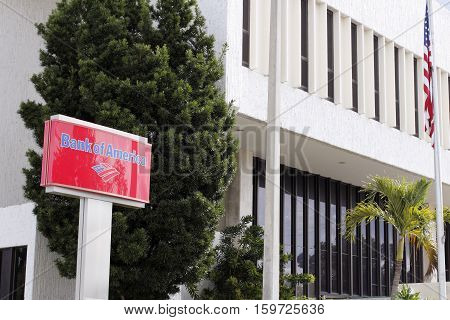 Fort Lauderdale FL USA - April 24 2016: Red blue and white Bank of America sign in front of the branches location. Bank of America first floor location with sign.
