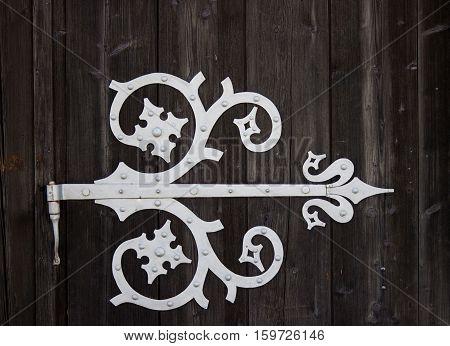Old great ironwork on wood dark background