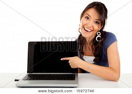 Happy woman pointing at a laptop computer screen� isolated over white