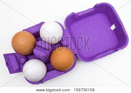 organic eggs of different colors isolated on white background