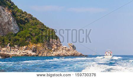 Motorboat Goes Near Rocks Of Capri Island, Italy